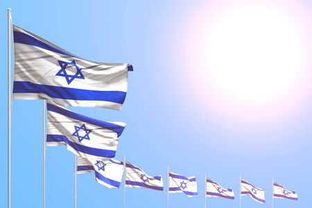 pretty many Israel flags placed diagonal on blue sky with place for your text - any occasion flag 3d illustration