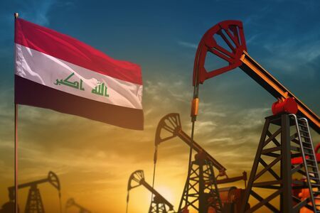 Iraq oil industry concept, industrial illustration. Fluttering Iraq flag and oil wells on the blue and yellow sunset sky background - 3D illustration Stok Fotoğraf - 134794773
