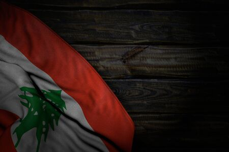 cute dark image of Lebanon flag with large folds on old wood with free space for text - any feast flag 3d illustration  Stok Fotoğraf