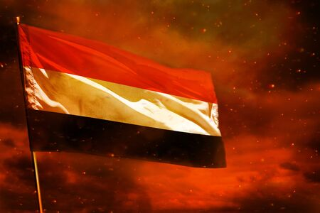 Fluttering Yemen flag on crimson red sky with smoke pillars background. Yemen problems concept. Stok Fotoğraf - 134852396
