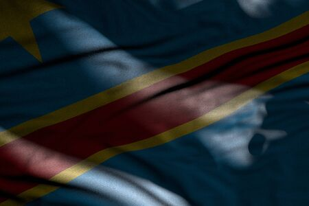 wonderful any feast flag 3d illustration  - illustration of dark Democratic Republic of Congo flag with folds lying flat in shadows with light spots on it