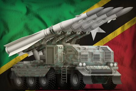 tactical short range ballistic missile with arctic camouflage on the Saint Kitts and Nevis flag background. 3d Illustration Stok Fotoğraf - 134852399