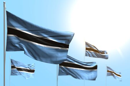cute 5 flags of Botswana are wave against blue sky picture with selective focus - any celebration flag 3d illustration