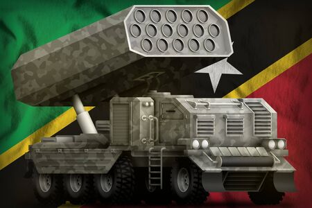 rocket artillery, missile launcher with grey camouflage on the Saint Kitts and Nevis flag background. 3d Illustration Stok Fotoğraf - 134852478