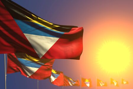 wonderful day of flag 3d illustration  - many Antigua and Barbuda flags on sunset placed diagonal with selective focus and place for text Banco de Imagens