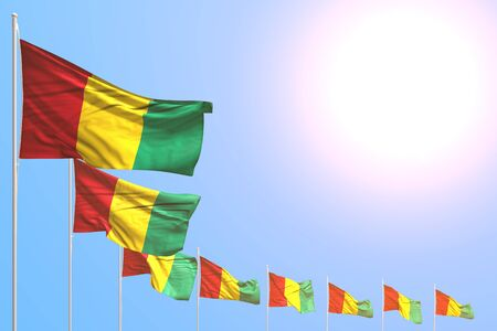 wonderful any celebration flag 3d illustration  - many Guinea flags placed diagonal on blue sky with space for your text