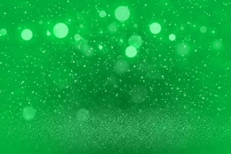 green nice brilliant abstract background glitter lights with sparks fly defocused bokeh - holiday mockup texture with blank space for your content Фото со стока