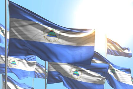 nice many Nicaragua flags are waving on blue sky background - any occasion flag 3d illustration Banco de Imagens - 134980606