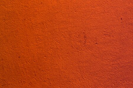 nice orange solid brushed stucco on the surface texture - abstract photo background