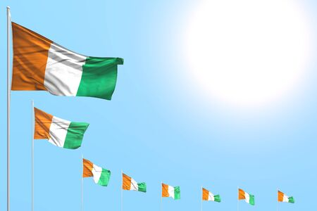 beautiful many Cote d Ivoire flags placed diagonal on blue sky with space for your text - any celebration flag 3d illustration