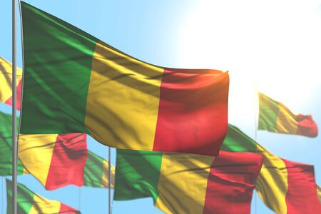 beautiful many Mali flags are wave against blue sky picture with soft focus - any occasion flag 3d illustration