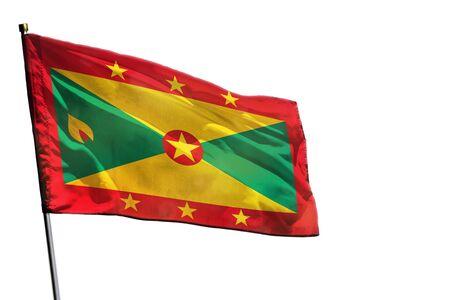 Fluttering Grenada flag isolated on white background.