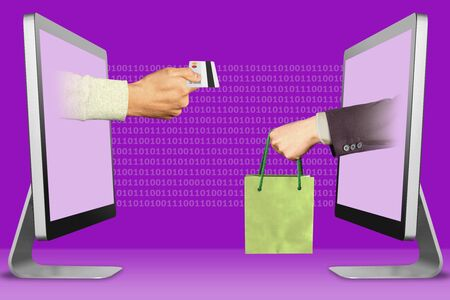 online concept, hands from laptops. hand with credit card and hand with shopping bag . 3d illustration