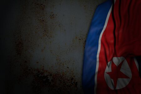 nice dark photo of North Korea flag with large folds on rusty metal with free space for text - any celebration flag 3d illustration  Banco de Imagens