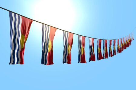 nice many Kiribati flags or banners hangs diagonal on string on blue sky background with bokeh - any occasion flag 3d illustration