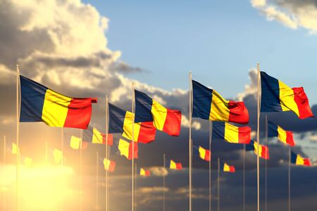 pretty many Romania flags on sunset placed in row with soft focus and place for your content - any feast flag 3d illustration