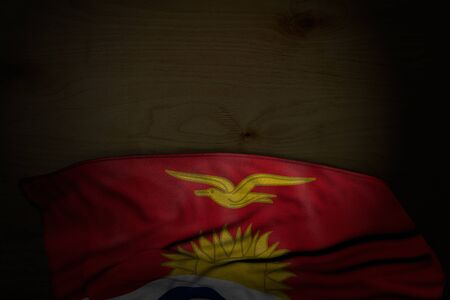wonderful dark illustration of Kiribati flag with big folds on dark wood with empty space for your content - any holiday flag 3d illustration  Stok Fotoğraf