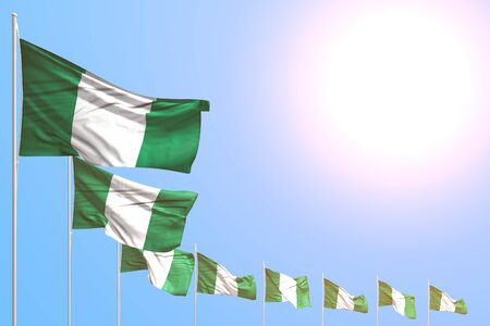 cute holiday flag 3d illustration  - many Nigeria flags placed diagonal on blue sky with space for your content