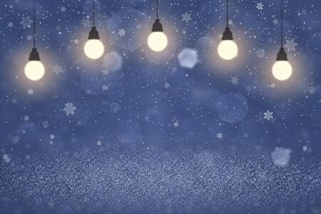 blue cute bright abstract background glitter lights with light bulbs and falling snow flakes fly defocused bokeh - holiday mockup texture with blank space for your content