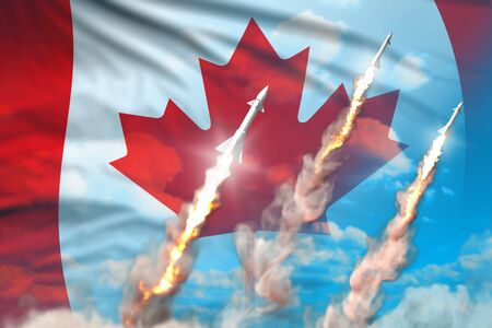 Modern strategic rocket forces concept on blue sky background, Canada supersonic warhead attack - military industrial 3D illustration, nuke with flag Stok Fotoğraf