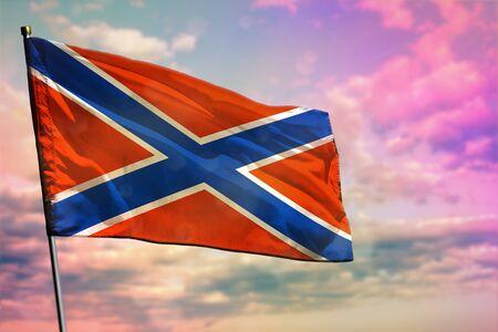 Fluttering Novorossiya flag on colorful cloudy sky background. Novorossiya prospering concept.