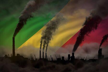 Dark pollution, fight against climate change concept - industrial 3D illustration of plant chimneys dense smoke on Congo flag background Stok Fotoğraf