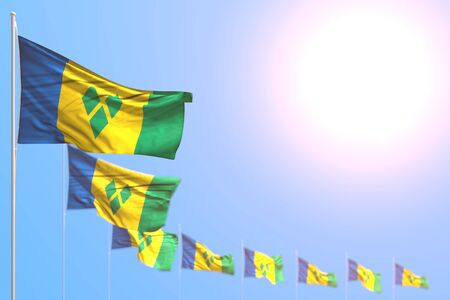 nice many Saint Vincent and the Grenadines flags placed diagonal with soft focus and free space for your text - any celebration flag 3d illustration