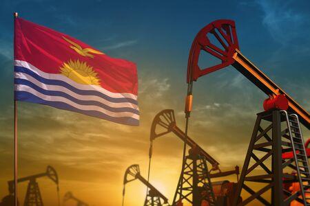 Kiribati oil industry concept, industrial illustration. Fluttering Kiribati flag and oil wells on the blue and yellow sunset sky background - 3D illustration
