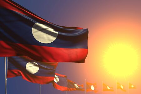 beautiful many Lao People Democratic Republic flags on sunset placed diagonal with bokeh and space for content - any feast flag 3d illustration