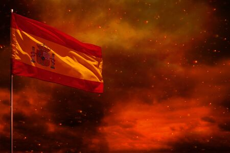 Fluttering Spain flag mockup with blank space for your data on crimson red sky with smoke pillars background. Spain problems concept.
