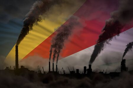 Global warming concept - heavy smoke from factory pipes on Seychelles flag background with space for your content - industrial 3D illustration Stock Photo
