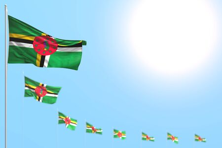 pretty national holiday flag 3d illustration  - many Dominica flags placed diagonal with soft focus and free space for your content