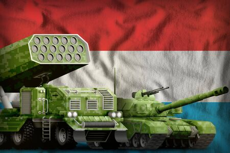 tank and rocket launcher with summer pixel camouflage on the Luxembourg flag background. Luxembourg heavy military armored vehicles concept. 3d Illustration