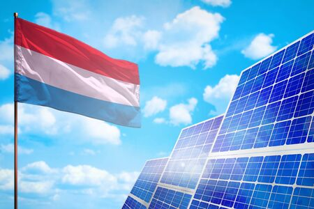 Luxembourg alternative energy, solar energy concept with flag - symbol of fight with global warming - industrial illustration, 3D illustration