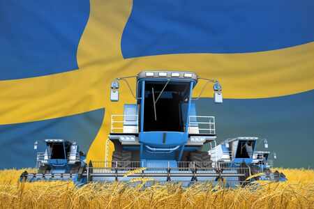 four light blue combine harvesters on farm field with flag background, Sweden agriculture concept - industrial 3D illustration