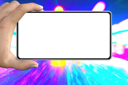 modern mockup - hand with phone with blank clear screen on neon city lights background, composed from real photography