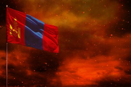 Fluttering Mongolia flag mockup with blank space for your data on crimson red sky with smoke pillars background. Mongolia problems concept. Banco de Imagens