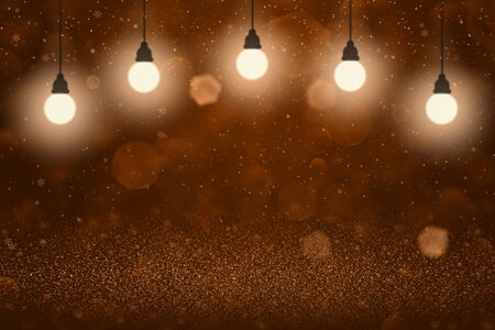 orange nice bright abstract background glitter lights with light bulbs and falling snow flakes fly defocused bokeh - celebratory mockup texture with blank space for your content