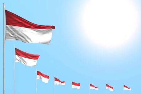 beautiful many Monaco flags placed diagonal on blue sky with place for text - any holiday flag 3d illustration