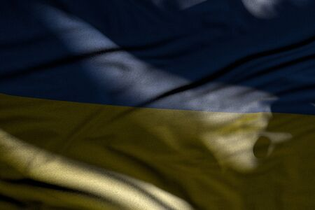 wonderful holiday flag 3d illustration - picture of dark Ukraine flag with folds lying flat in shadows with light spots on it