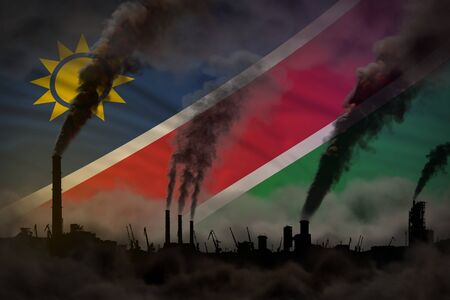 Global warming concept - heavy smoke from industrial chimneys on Namibia flag background Stock fotó