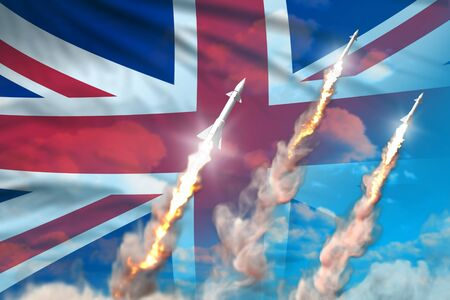 Modern strategic rocket forces concept on blue sky background, United Kingdom (UK) supersonic warhead attack - military industrial 3D illustration, nuke with flag