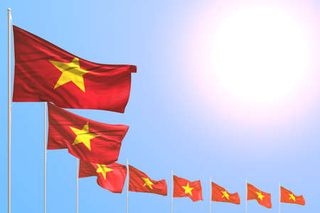 wonderful many Vietnam flags placed diagonal on blue sky with place for your text - any occasion flag 3d illustration Banco de Imagens