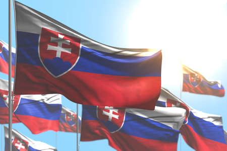 cute many Slovakia flags are waving against blue sky picture with selective focus - any celebration flag 3d illustration