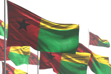 pretty many Guinea-Bissau flags are waving isolated on white - image with soft focus - any occasion flag 3d illustration Banco de Imagens