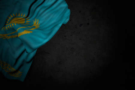 beautiful dark picture of Kazakhstan flag with large folds on black stone with free place for your content - any celebration flag 3d illustration 写真素材