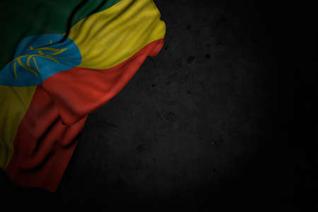 beautiful dark illustration of Ethiopia flag with big folds on black stone with free space for text - any feast flag 3d illustration 写真素材