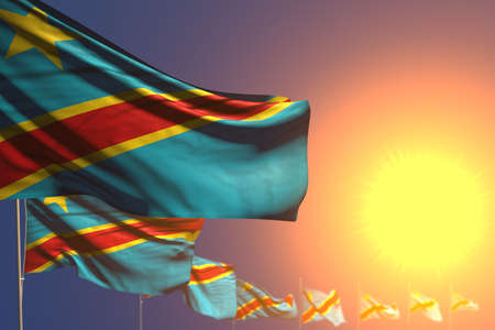 cute many Democratic Republic of Congo flags on sunset placed diagonal with bokeh and place for text - any occasion flag 3d illustration 版權商用圖片