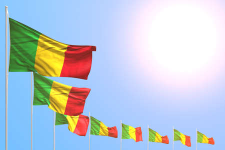 cute many Mali flags placed diagonal on blue sky with space for your text - any holiday flag 3d illustration 版權商用圖片