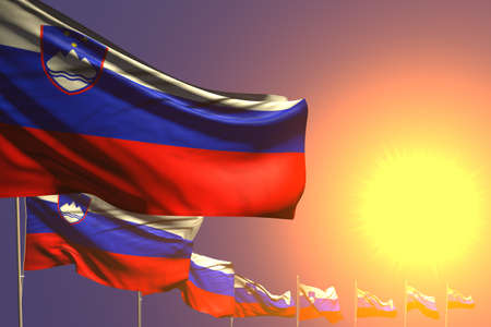 nice anthem day flag 3d illustration - many Slovenia flags placed diagonal on sunset with space for text
